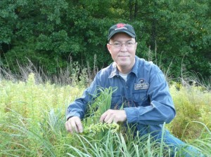 Dr. Grant Woods with sericea lespedeza