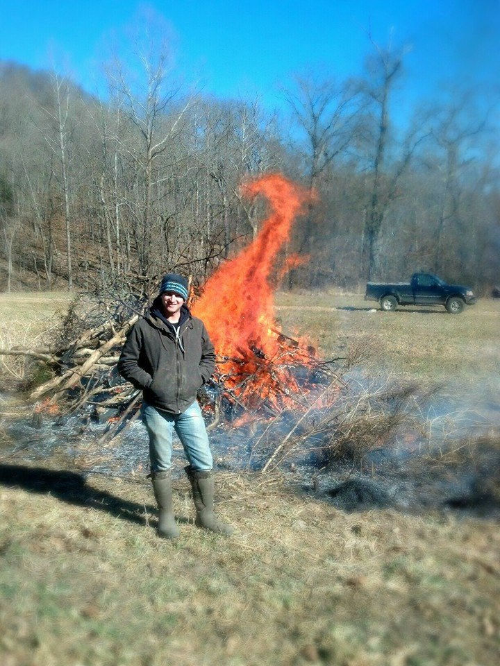 A burning brush pile in the center of a food plot