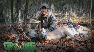 Aaron answers the phone while filming his buck kill interview.