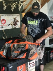Daniel fills a Scent Crusher Ozone Tote with hunting gear.