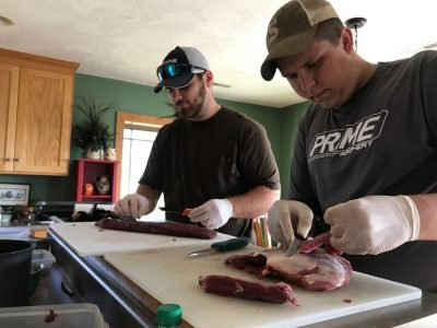 Trimming connective tissue off of venison