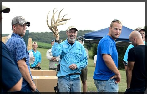 Grant holds up a matching set of shed antlers