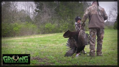 A father and son with a gobbler