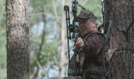 bow hunter in treestand
