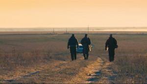 Three hunters walking to vehicle