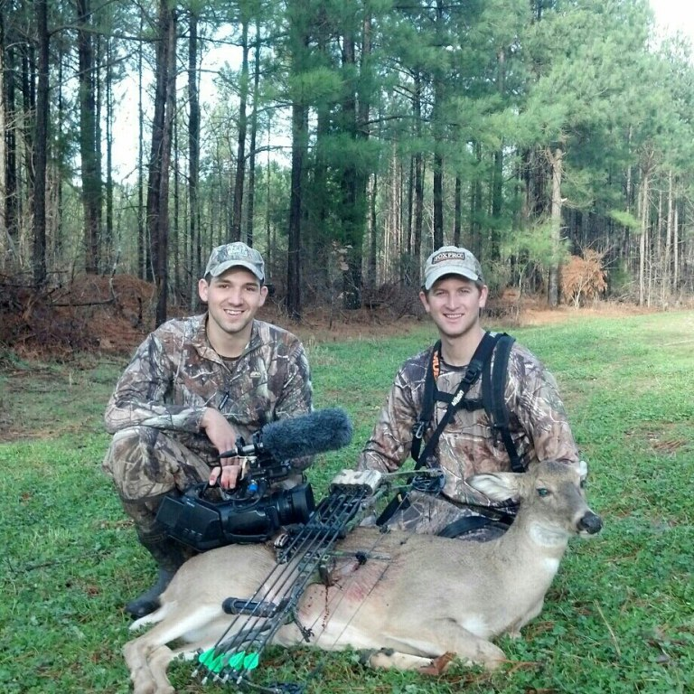 Brian and Adam with a mature doe shot in a clover food plot in Kentucky