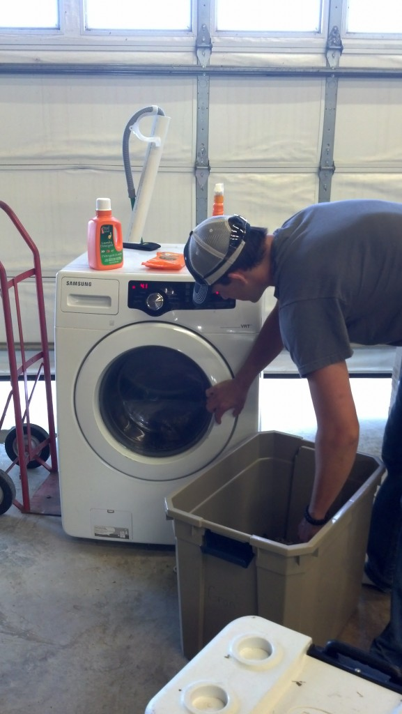 Adam washes clothse with Dead Down Wind in preparation for hunting season.