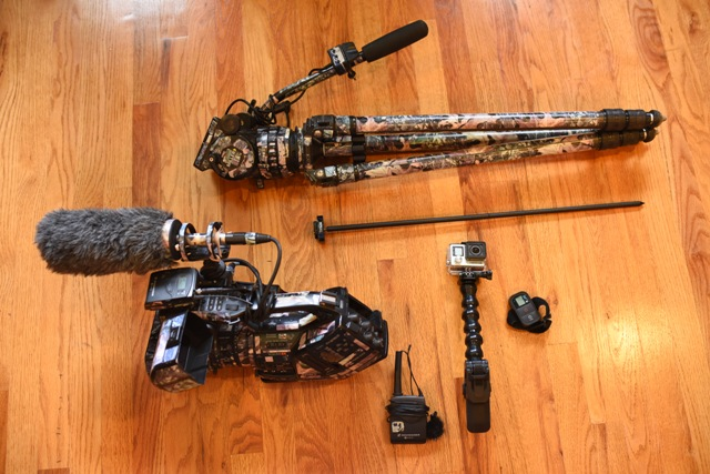 Sony EX3 with lavalier and shotgun mics, tripod, and GoPro with remote and ground stake.
