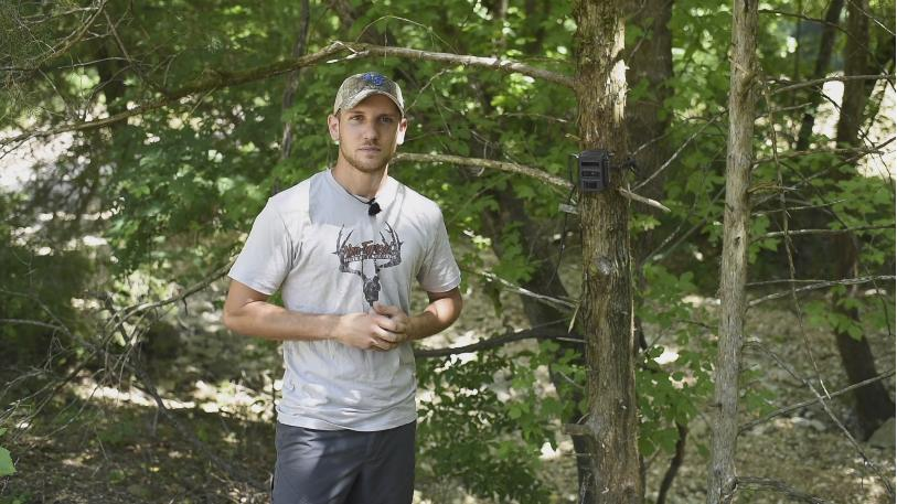 Matt at a Reconyx trail camera.