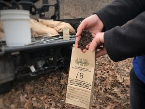 Putting soil into a bag for testing.