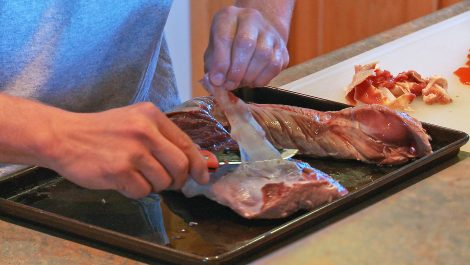 Cleaning a venison backstrap before packaging