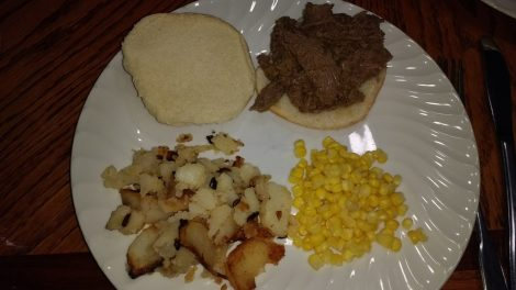 BBQ venison sandwich with potatoes and corn