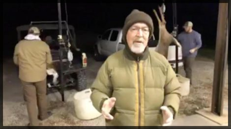 Grant answers questions at the skinning shed