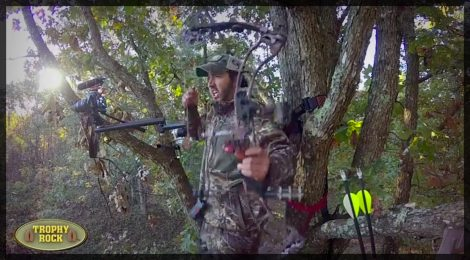 A hunter holds a Prime bow