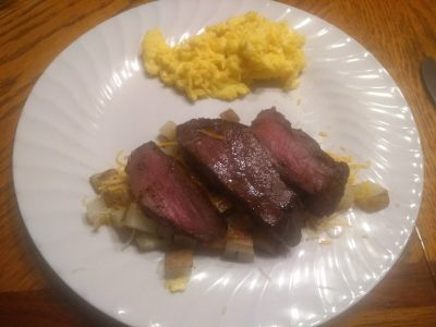 Venison steak with scrambled eggs and potatoes for breakfast