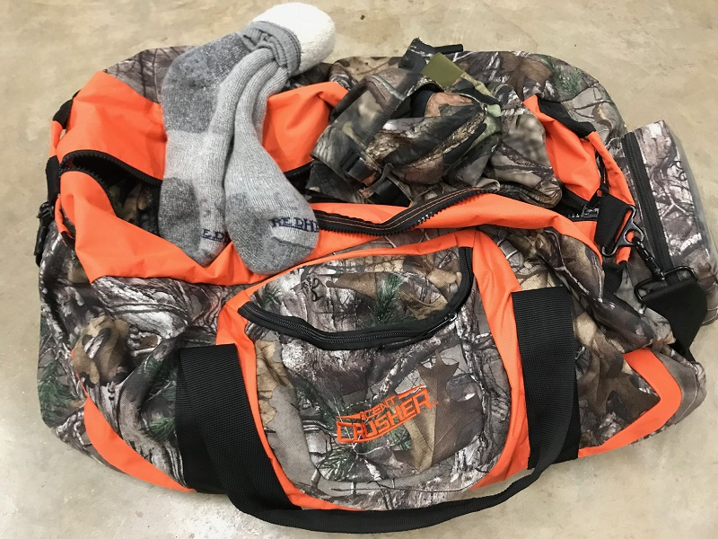hunting clothes in a scentcrusher bag