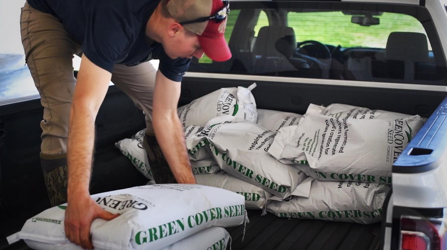 Spring Release Food Plot seeds from Green Cover Seed being loaded in truck by Clay